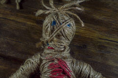 Voodoo Doll. On wooden background Stock Photography