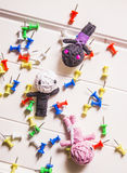 Voodoo Dolls Surrounded By Colorful Thumbtacks Stock Image
