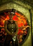 Voodoo Mann mit einem Kreisfenster hinter voll des Feuers Stockfotos