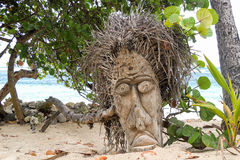 Voodoo mask on a beach Royalty Free Stock Photography