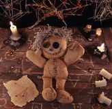 Voodoo ritual with doll and magic objects Royalty Free Stock Image