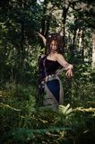 Voodoo witch in the woods. Evil and dirty. Hides in the woods Royalty Free Stock Photo