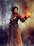 Voodootrollkvinna med en flamma royaltyfri bild