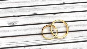 Voor altijd verbonden gouden bruiloftringen stock foto's