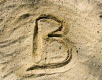 Voor B op zand Stock Afbeelding