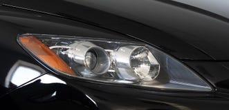 Voor lichten van een auto stock afbeeldingen