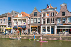 Voordam canal with paddle surfers, Alkmaar, Netherlands Stock Photography