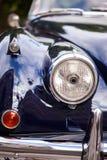 Voordeel met koplamp van Britse retro autokoplamp stock afbeelding