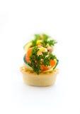 Voorgerecht met een zalm door een komkommer en een citroen Stock Foto