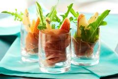 Voorgerecht met peer, prosciutto, arugula, gorgonzola royalty-vrije stock fotografie