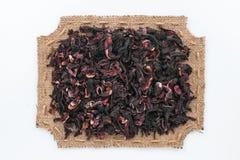 Voorgesteld kader van jute met hibiscus Stock Foto