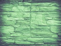 Voorgeveltegels die steentextuur in groene tonen imiteren stock afbeelding