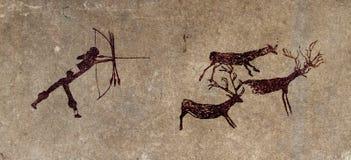 Voorhistorische jager - grotschilderingsreproductie stock foto