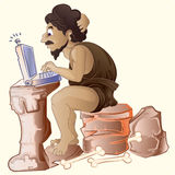 Voorhistorische mensen werkende laptop Royalty-vrije Stock Foto