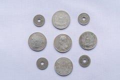 Vor thailändische Währungsmünzen sind verwendeten hundert Jahren gewesen stockfotos