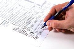 Vorbereiten von Steuern Stockfotos