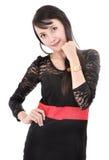 Vorbildliche Aufstellung der Schönheit im eleganten Kleid Lizenzfreies Stockfoto