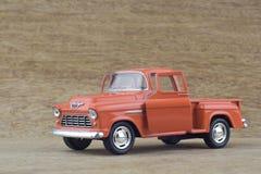 Vorbildliche Motor- 1955 Chevrolet-Aufnahme - orange Farbe lizenzfreies stockbild