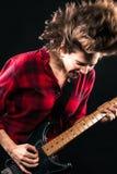 Vorbildlicher Red Flannel Shirt-E-Gitarren-Haar-leichter Schlag Lizenzfreies Stockbild