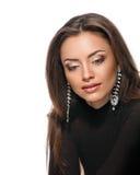 Vorbildliches Gesicht, Lippenmake-up, Ohrring stockbild
