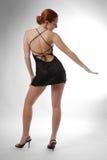 Vorbildliches Tanzen im kurzen Kleid, hintere Ansicht Stockbilder