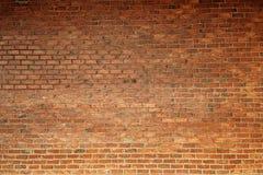 Vorderansicht der orange rauen Backsteinmauerbeschaffenheit, Stockfotografie