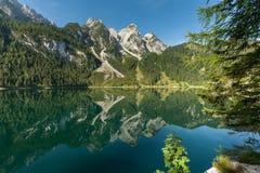 Vorderer Gosausee in Austria in summer, reflection in water. Vorderer Gosausee in Salzkammergut Austria in summer, reflection in water Stock Image