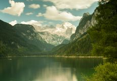 Vorderer Gosausee in Austria in summer, reflection in water, Dac. Vorderer Gosausee in Salzkammergut Austria in summer, reflection in water Royalty Free Stock Photography