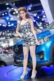 Vorführer im sexy Kleid an der 30. internationalen Bewegungsausstellung Thailands am 3. Dezember 2013 in Bangkok, Thailand Lizenzfreie Stockfotografie