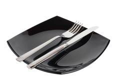 Vork & mes op een zwarte plaat Royalty-vrije Stock Foto