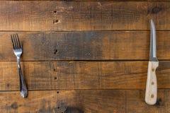Vork en mes op hout Stock Afbeelding