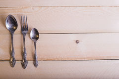 Vork, lepel, mes op de houten lijstachtergrond met exemplaar plac Royalty-vrije Stock Afbeelding