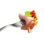 Vork met vlees en tomaat stock fotografie