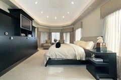Vorlagenschlafzimmer im Luxuxhaus Stockfotografie