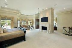 Vorlagenschlafzimmer mit Kamin Stockbilder