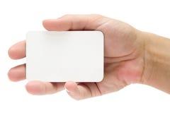 Vorlegen einer Kreditkarte Stockbild