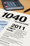 Vorm 1040 De Instructies van de Inkomstenbelasting Stock Foto