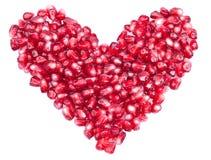 Vorm van een hart dat uit granaatappelzaden wordt gemaakt Stock Fotografie