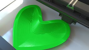 Vorm van het druk de plastic groene hart met een 3D printer, het 3D teruggeven Stock Afbeelding