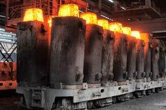 Vormen van de verwarmde staalvarkens stock foto