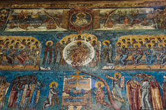 Voronet Church Painting Detail. A detailed picture of one of the outside walls of the Voronet Church with the angels and the zodiac signs. This church is one of Royalty Free Stock Photos