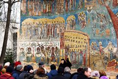 A large group of tourist visit Voronet Monastery royalty free stock image