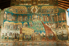 Voronet Monastery - Last Judgement painting. Voronet Monastery - west end, with Last Judgement painting dating from 1547 to 1550. Voronet is a UNESCO World Stock Photos
