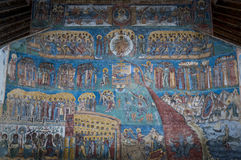 Voronet Monastery. The Voronet Monastery - one of the famous painted monasteries in Romania. The painting is the Last Judgement on the exterior western wall Stock Photography