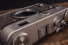 Voronezh Russia 02 april 2019 old vintage soviet camera with lens on wooden background. stock photos