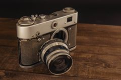 Voronezh Russia 02 april 2019 old vintage soviet camera with lens on wooden background royalty free stock photography