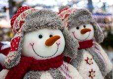 Free Voronezh, Russia - December 22, 2019: Toys Snowmen In Winter Hats With Earflaps And Scarves Royalty Free Stock Photo - 195001155