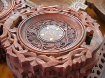Carved wooden plate with indian ornament. Voronezh, Russia, July 08, 2014: Carved wooden plate with indian ornament stock photography