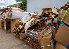 Cardboard boxes are stacked at the waste paper reception point. Voronezh, Russia - June 14, 2017: Cardboard boxes are stacked at the waste paper reception point royalty free stock images