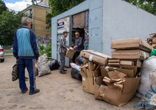 People carry waste paper to the recycling station, the city of Voronezh Stock Image